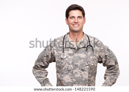 Portrait of a young military doctor  - stock photo