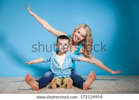 Portrait of a young mother and small son having fun. Family, adorable kid, love and happiness concept - stock photo