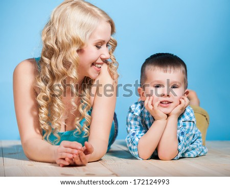 Portrait of a young mother and small son having fun. Family, adorable kid, love and happiness concept