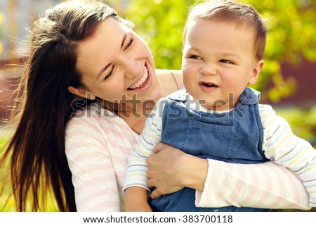 portrait of a young mother with her baby. Mom and son
