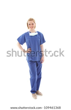 Portrait of a young nurse in scrubs Full length portrait of a friendly young theatre nurse in blue scrubs isolated on white - stock photo