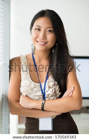 Portrait of a young office worker looking at camera and smiling