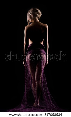 Portrait of a young outgoing beautiful woman in a lite purple dress - stock photo