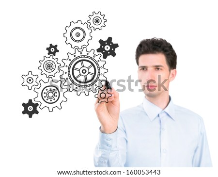 Portrait of a young pensive businessman holding a marker and drawing a concept of business development process. Isolated on white background.