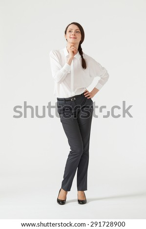 Portrait of a young pensive businesswoman, white background - stock photo