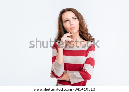 Portrait of a young pensive woman looking away at copyspace isolated on a white background - stock photo