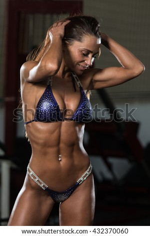 http://thumb1.shutterstock.com/display_pic_with_logo/1623779/432370060/stock-photo-portrait-of-a-young-physically-fit-woman-showing-her-well-trained-body-muscular-athletic-432370060.jpg