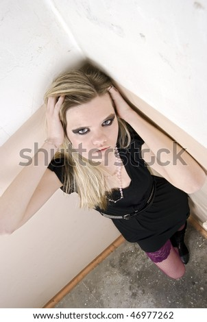 Portrait of a young posing woman - stock photo