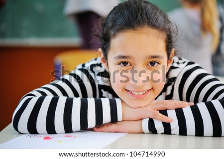 Portrait of a young pretty arabic schoolgirl - stock photo