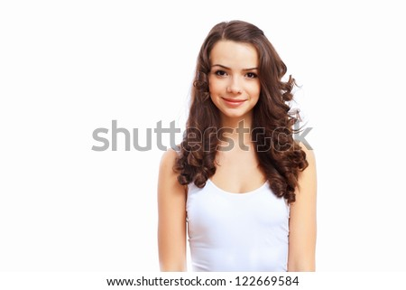 Portrait of a young pretty brunette woman against white background - stock photo