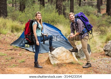 Portrait of a young pretty hiker couple in the nature - stock photo