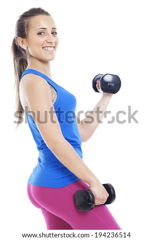 portrait of a young pretty woman holding weights and doing fitness