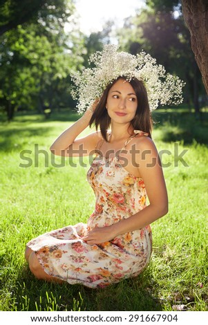portrait of a young pretty woman in a wreath