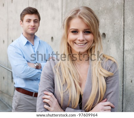 portrait of a young professional businessman and businesswoman - stock photo
