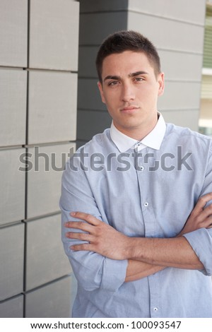 Portrait of a young professional man standing outside a building
