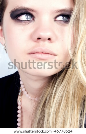 Portrait of a young prostitute crying in bath - stock photo