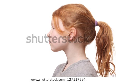 Portrait of a young red haired girl with ponytail on white background - stock photo
