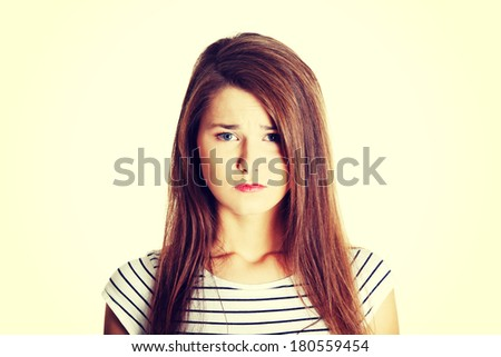 Portrait of a young sad female caucasian teen, on white. - stock photo