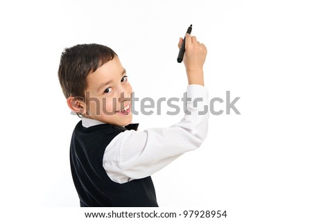 portrait of a young school boy wrighting or drawing something with black point pen isolated on white background