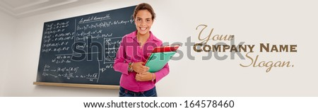Portrait of a young schoolgirl with a blackboard with formulae as background  - stock photo