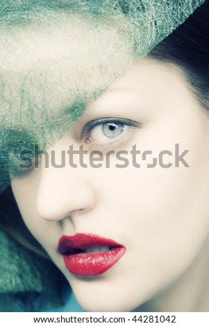 Portrait of a young sexual female in hat close up