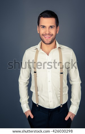 Portrait of a young sexy man with beaming smile - stock photo