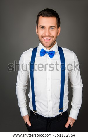 Portrait of a young sexy man with beaming smile and bow-tie - stock photo