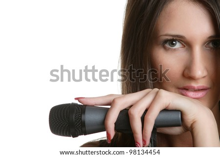 portrait of a young singer with a microphone - stock photo