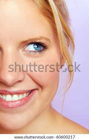 portrait of a young smiling blond woman - stock photo