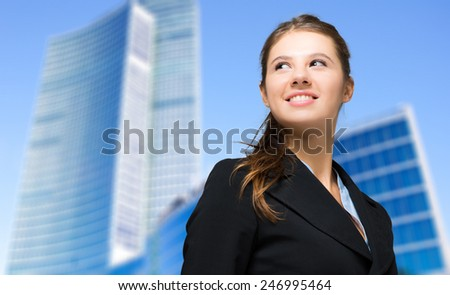 Portrait of a young smiling business woman - stock photo