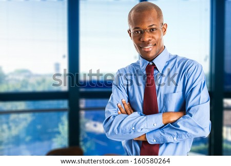 Portrait of a young smiling businessman - stock photo