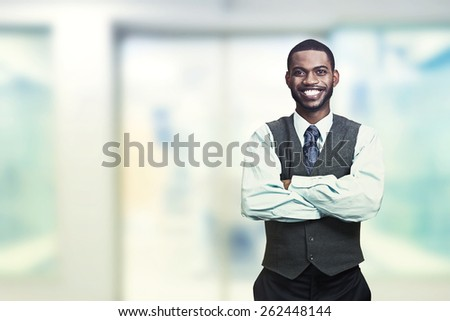 Portrait of a young smiling businessman. Positive face expression   - stock photo