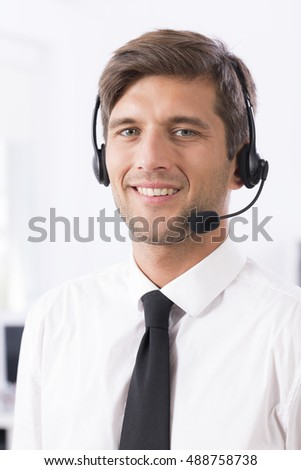 Portrait of a young smiling call center agent
