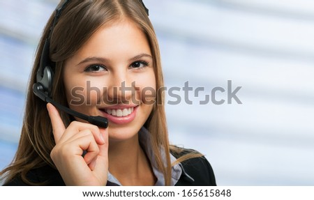 Portrait of a young smiling customer representative