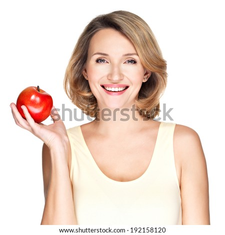 Portrait of a young smiling healthy woman with red apple - isolated on white. - stock photo