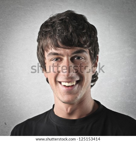 Portrait of a young smiling man - stock photo