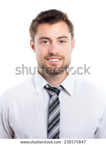 Portrait of a young smiling man against white background