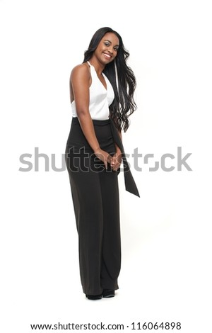 Portrait of a young smiling woman - full length - stock photo