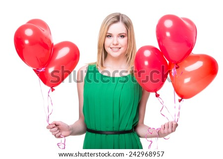 Portrait of a young, smiling woman with colored balloons on a white background.