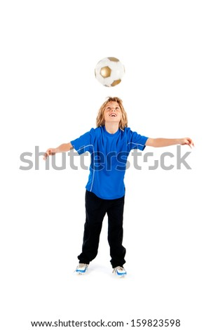 Portrait of a young soccer player heading ball isolated over white background