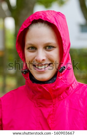 Portrait of a young, sporty woman in a rain jacket