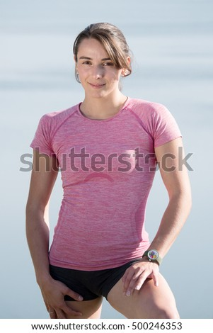 portrait of a young sporty woman in the countryside
