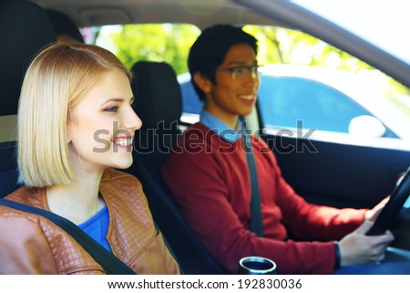 Portrait of a young students in car
