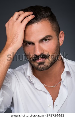 portrait of a young stylish man with mustache