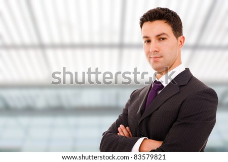 Portrait of a young successful business man at a modern office bulding - stock photo
