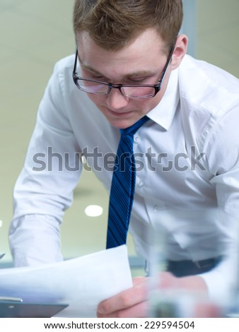 Portrait of a young successful man in the office - stock photo