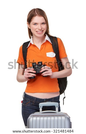 Portrait of a young teen girl holding binoculars and smiling at camera, over white background