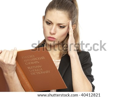 Portrait of a young thoughtful woman with english-russian dictionary. Isolated over white background