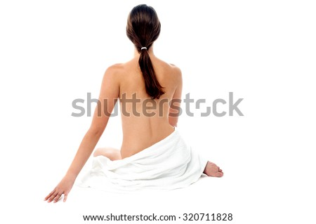 Portrait of a young topless woman - stock photo