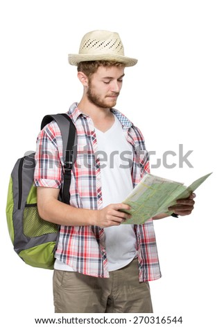 portrait of a young traveling man with backpack looking for and reading map isolated on white background - stock photo